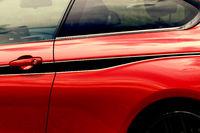Detail on hot red sport car - car door handle