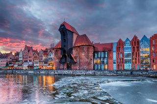 Gdansk Zuraw, a famous sight on the bank of Motlawa river, winter sunset