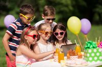 happy kids with tablet pc on birthday party