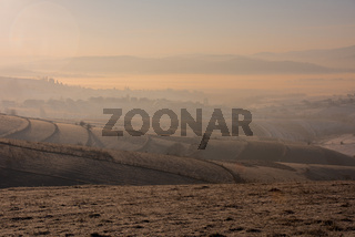 winter landscape with fog and pollution