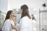 Professional make up artist doing make up in beauty salon