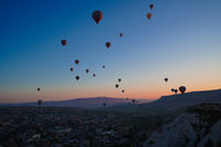 Sunrise panoramic view to Goreme city and flying balloons, Cappadocia, Turkey