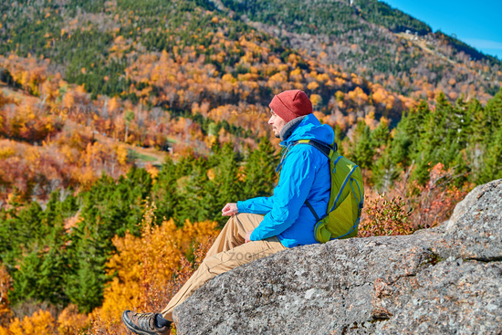 Backpacker man at Artist's Bluff in autumn