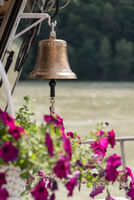 shining ship bell hangs for alert signal - close up alarm bell