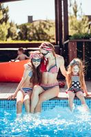 Happy mother and two daughters have fun
