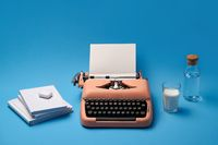 Composition with typewriter, books, glass and bottle