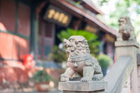 Lion stone statue in a buddhist temple
