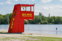 vibrant red lifeguard station or tower at bathing lake in Germany