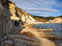 Cala d'Hort beach and boat garages. Ibiza Island, Balearic Islands. Spain