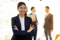 asian businesswoman with business team
