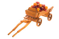 Antique wooden farmers cart with fresh fruit