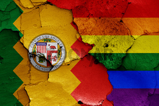 flags of Los Angeles and LGBT painted on cracked wall