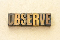 observe word abstract in wood type