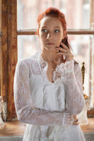 Portrait of a alluring redhead woman.