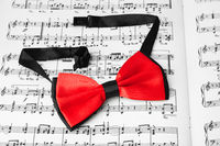 Red bow tie on music sheet