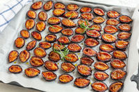 Dried plums with spices and rosemary.