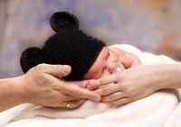 Newborn Baby Boy Sleeping on Parents Hands