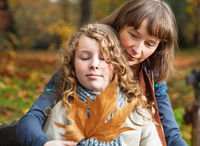 Mother and daughter in an autumn park