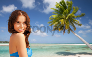 happy woman in bikini swimsuit on tropical beach