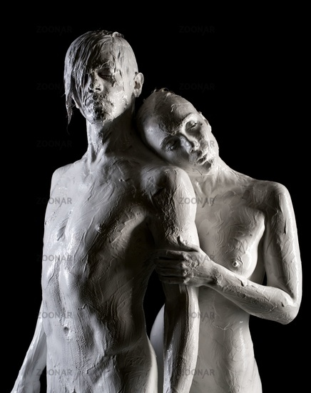 Naked male and female posing like statues