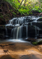 Water cascades over rocks in Leura