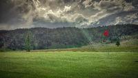 Golf Hole with Sunbeam in Fairmont Springs Resort, Montana