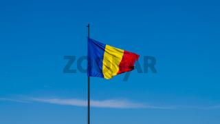 Romanian flag waving on a sunny summer day in Alba Iulia, Romania