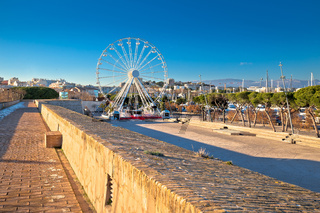 Giant Ferris wheel in Antibes colorful view