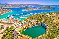 Rogoznica turquoise bay and Dragon Eye lake aerial view