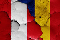 flags of Peru and Romania painted on cracked wall