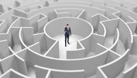 Businessman standing in a middle of a round maze