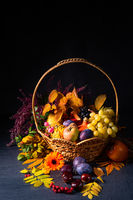 autumnal cornucopia in round basket