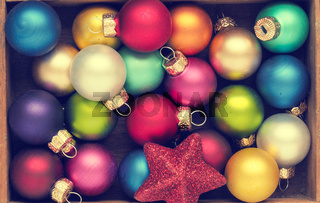 Colorful vintage Christmas baubles in a box