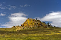 Eroded granite hill in the steppe, Mongolia