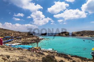 Comino Island, Malta Blue Lagoon panoramic landscape with bathers.