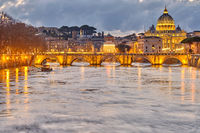 St. Peter's cathedral and Tiber river at evening in Rome