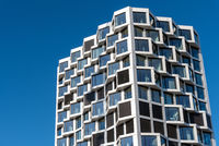 Facade of modern high-rise residential building seen in Munich, Germany