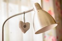 Cloth heart decoration hanging on lamp pillar