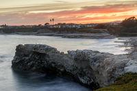 Summer sunset above Natural Bridges State Beach.