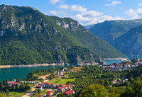 Piva Lake (Pivsko Jezero) and Pluzine town view in Montenegro.