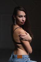 Young nice brunette posing in studio.