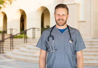 Caucasian Male Nurse In Front Of Hospital Building