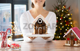 close up of woman with christmas gingerbread house