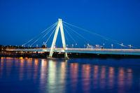 Illuminated bridge accross the river Rhein in Cologne