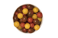 Cherry tomatoes, red,yellow and kamato in ceramic bowl on white background. Top view.
