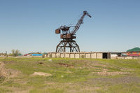 Port crane in an abandoned fishing port on the dried Aral sea