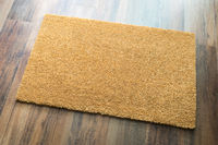 Blank Welcome Mat On Wood Floor Background Ready For Your Own Text
