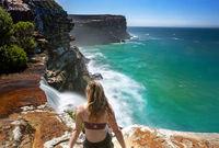 Watching waterfalls flow into the ocean