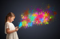 Girl holding tablet with colourful splash around