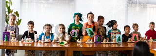 Russia, Khabarovsk - Jan 15, 2018: children's master class on making Christmas trees from cookies and Christmas cards